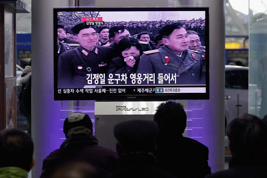 People watch a television broadcast reporting the late North Korean leader Kim Jong-Il's funeral at the Seoul Railwat Station on December 28, 2011 in Seoul, South Korea.
