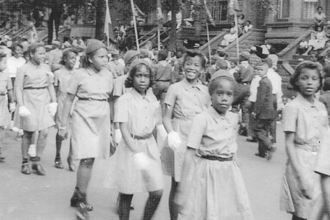 A girl scout troupe marching in parade in Bedford-Stuyvesant, Brooklyn in the 1960s