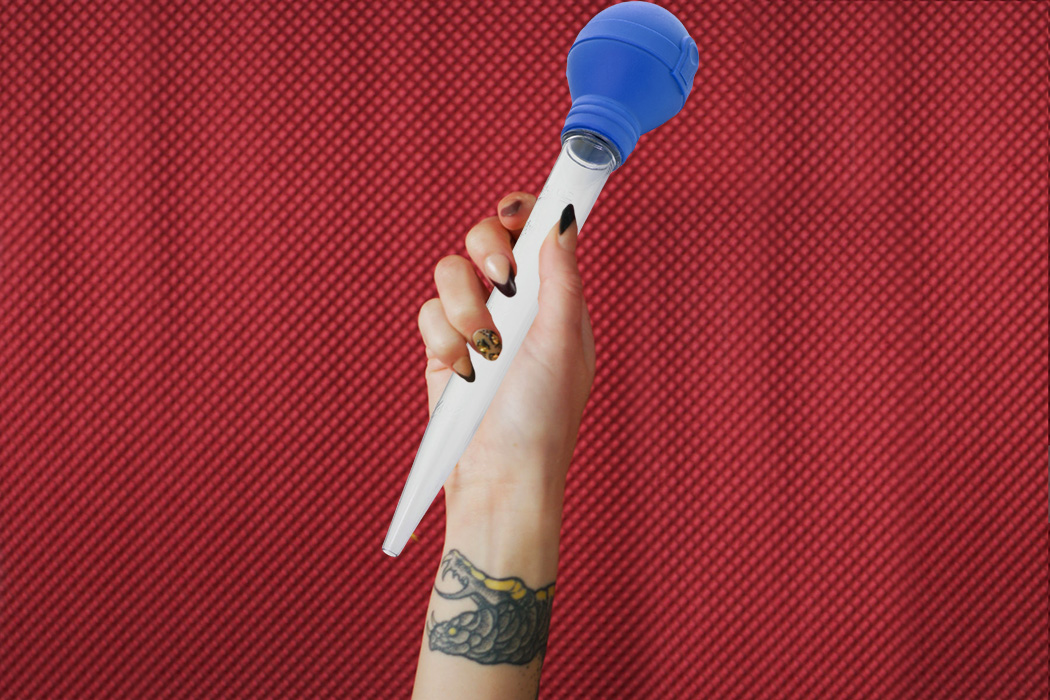 A woman's hand holding a turkey baster