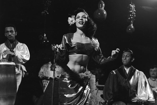Mango the Mambo dancer performs on stage with drum accompaniment, 1954