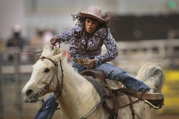 A cowgirl participates in the barrel race competition at the Bill Pickett Invitational Rodeo on April 1, 2017 in Memphis, Tennessee.