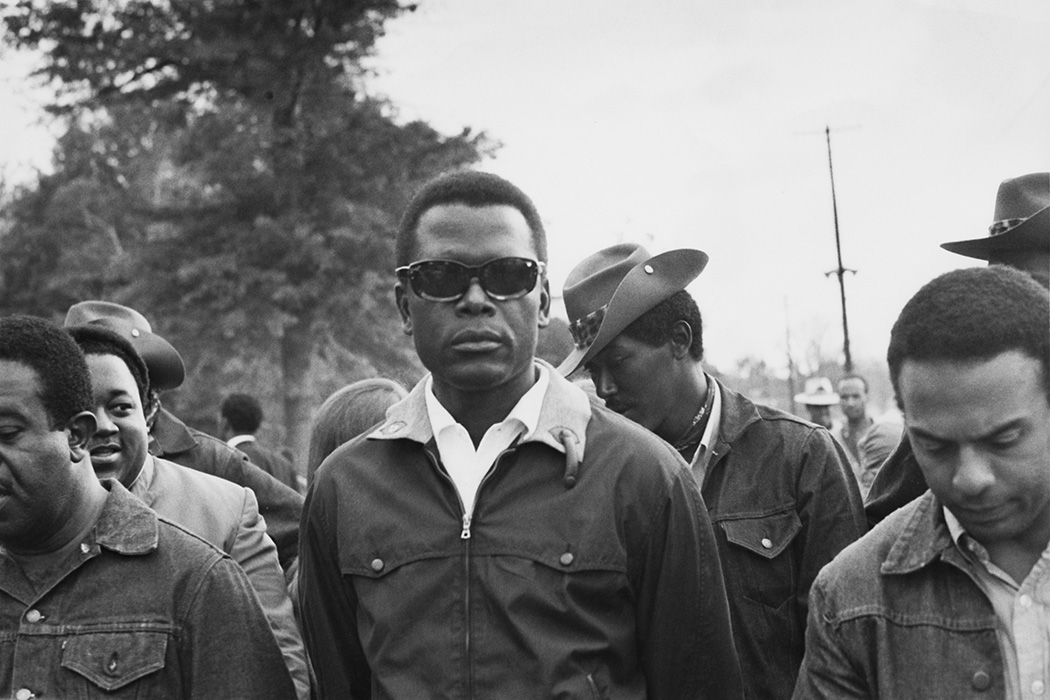 Photograph: Bahamian-American actor and civil rights activist Sidney Poitier (centre) suporting the Poor People's Campaign at Resurrection City, a shantytown set up by protestors in Washington, DC, May 1968.   Source: Chester Sheard/Keystone/Hulton Archive/Getty Images
