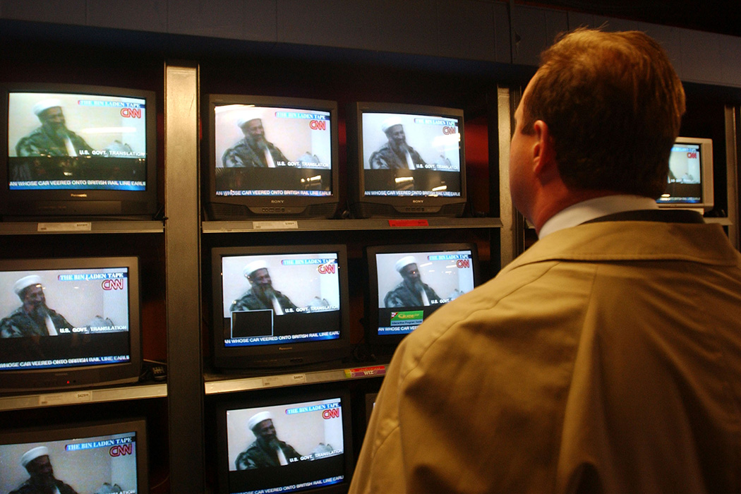 A man watches the CNN broadcast of the Osama bin Laden tape December 13, 2001 in a New York City store after it was released by the Pentagon.