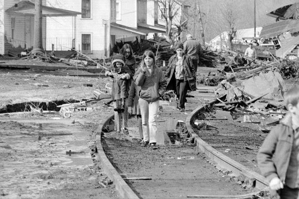Children walk along the tracks in what remains of their community along Buffalo Creek on Feb. 27, 1972.