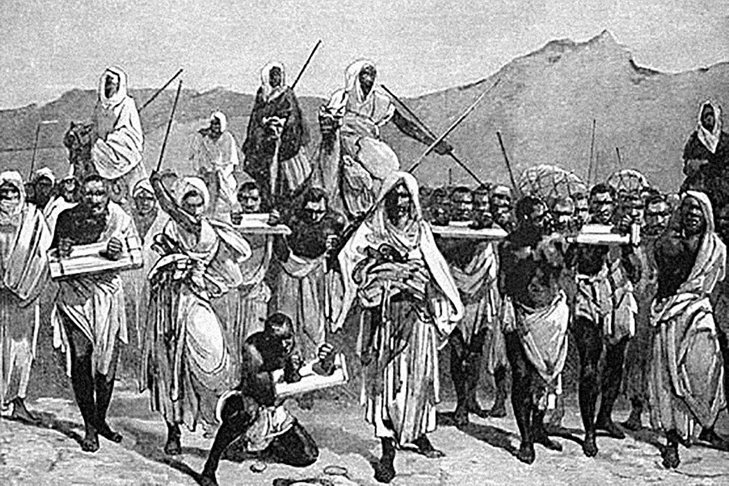 A 19th-century engraving depicting an Arab slave-trading caravan transporting black African slaves across the Sahara.