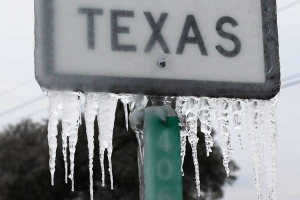 Photograph: Icicles hang off the  State Highway 195 sign on February 18, 2021 in Killeen, Texas.  Source: Joe Raedle/Getty