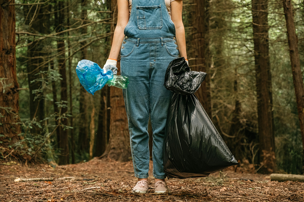 Volunteer collecting garbage from park