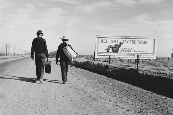 Two people walking towards Los Angeles, 1937