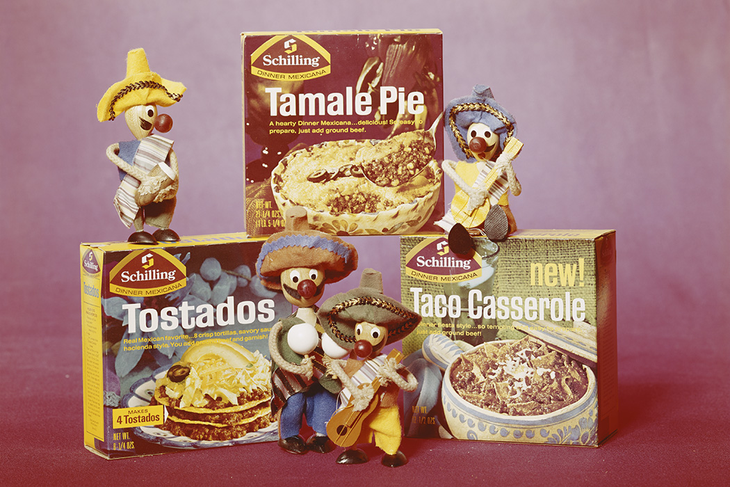 Boxes of tamale pie, tostadas and taco casserole with figurine