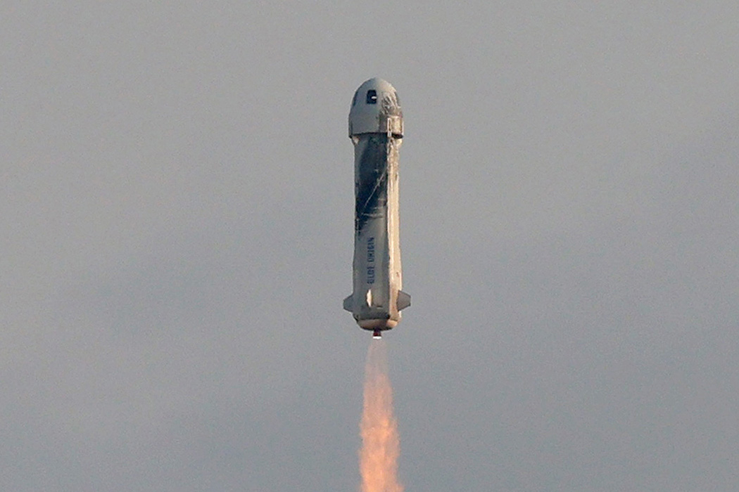 The New Shepard Blue Origin rocket lifts-off from the launch pad carrying Jeff Bezos along with his brother Mark Bezos, 18-year-old Oliver Daemen, and 82-year-old Wally Funk
