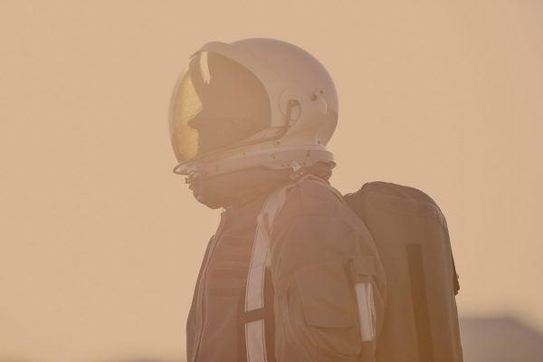 Portrait of astronaut in space suit and helmet