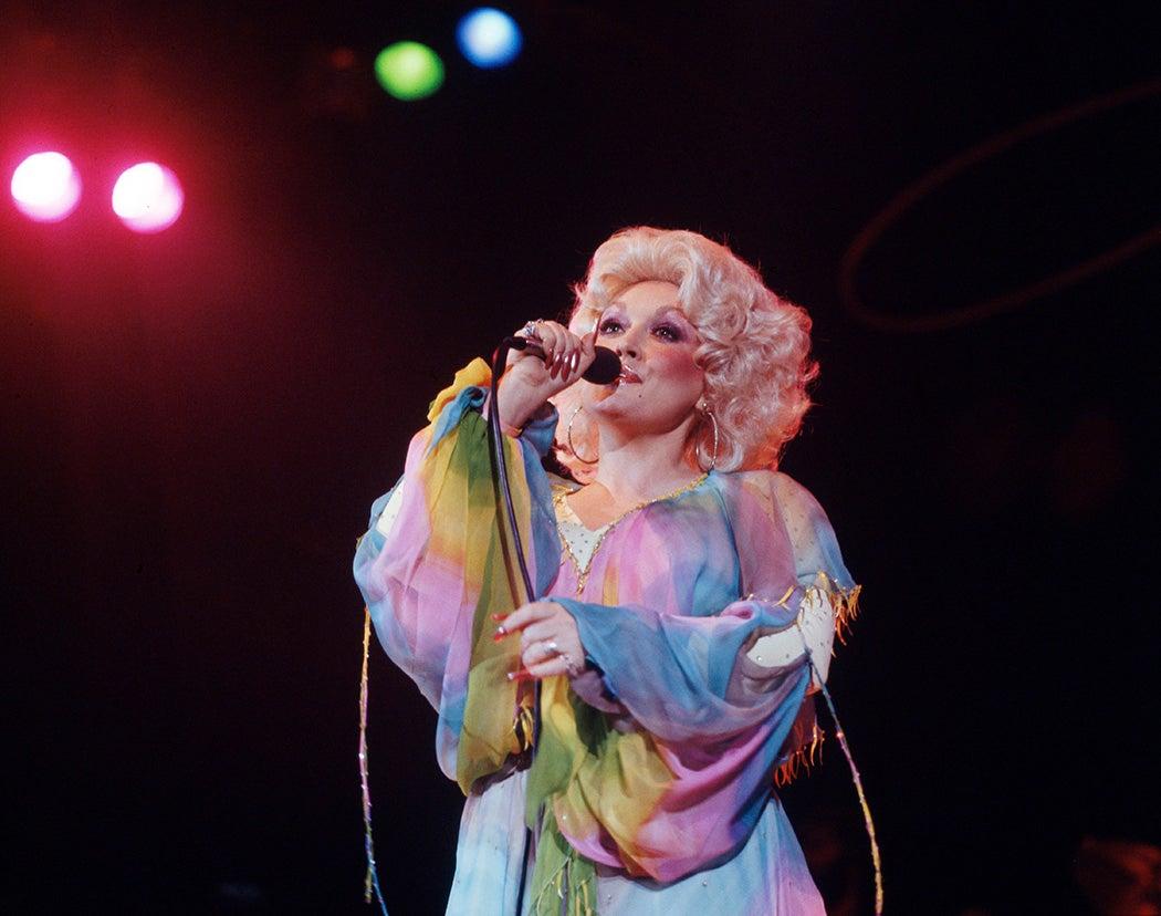 Dolly Parton performs onstage in 1978