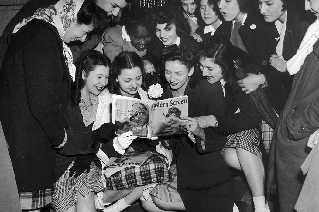 Photograph: Female fans of Frank Sinatra gaze adoringly at a picture of him in a copy of Modern Screen magazine, c. 1950  Source: Getty