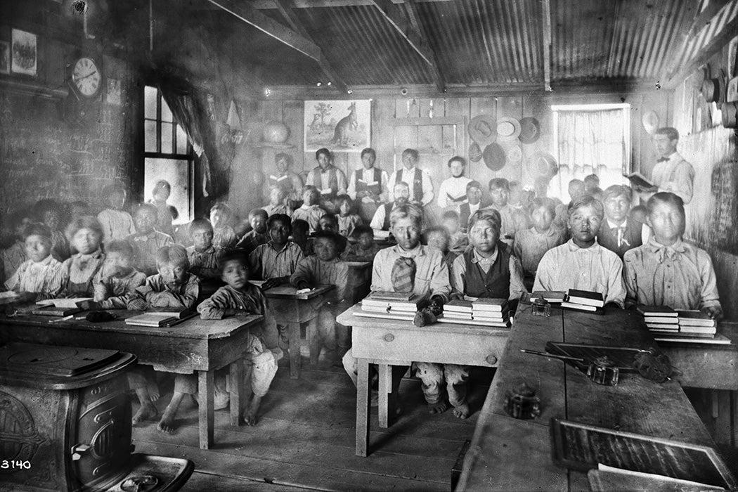 Classroom of students with their teachers inside a Walapai school at Hackbury, Arizona, circa 1900