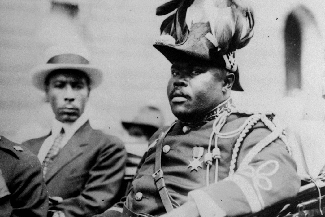 """Marcus Garvey is shown in a military uniform as the """"Provisional President of Africa"""" during a parade on the opening day of the annual Convention of the Negro Peoples of the World at Lenox Avenue in Harlem, New York City, 1922"""