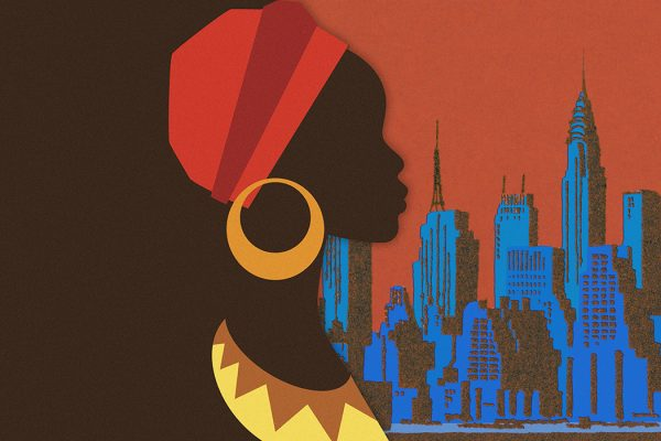 A person in African clothing with New York City in the background
