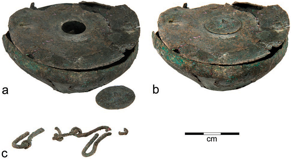 Parts of a bronze inkwell from Tel Kedesh: a, bowl with small cover removed; b, bowl with small cover in place; c, frag- ments of a chain that probably once stretched across the top of the lid