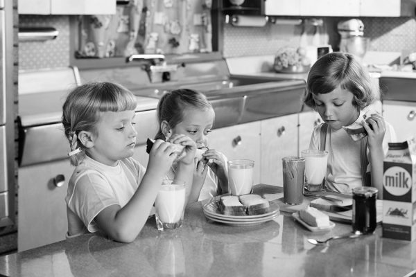 THREE GIRLS SISTERS EATING LUNCH AT KITCHEN TABLE PEANUT BUTTER & JELLY