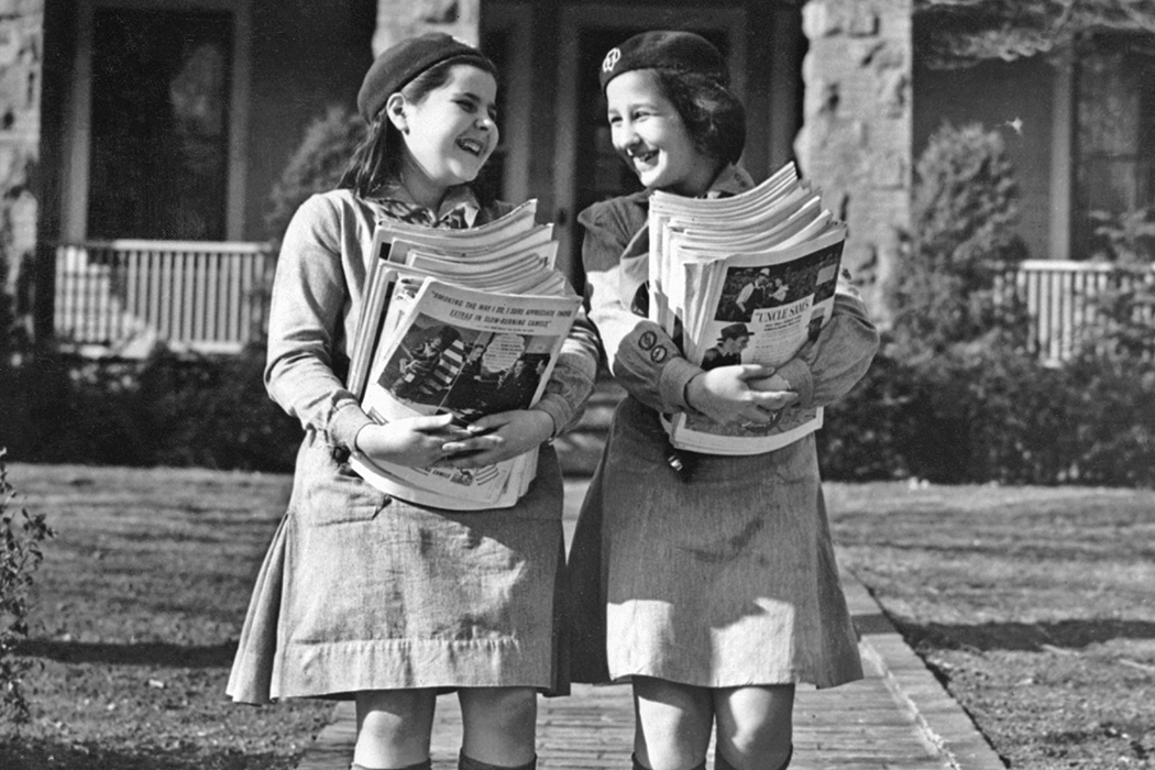 Two Girl Scouts collecting magazines