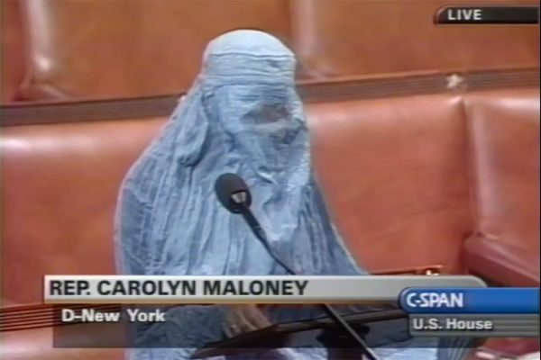 Rep. Carolyn Maloney (D-NY) wears a traditional Afghani burqa while giving a speech in support of Afghan women's rights and American involvement against Taliban in the United States House of Representatives, October 16, 2001