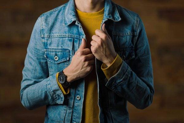 A person wearing a denim jacket