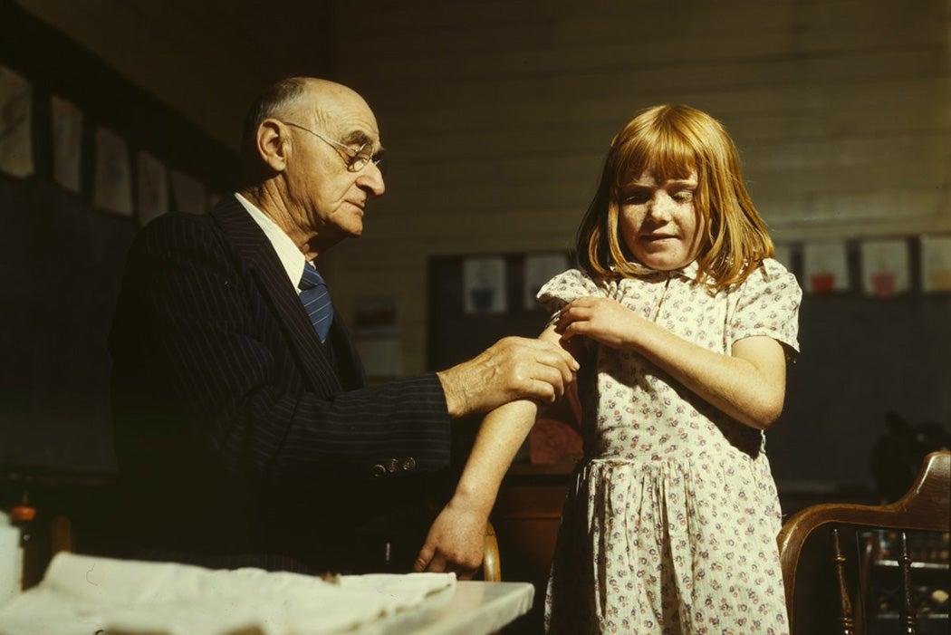 Dr. Schreiber of San Augustine giving a typhoid innoculation at a rural school