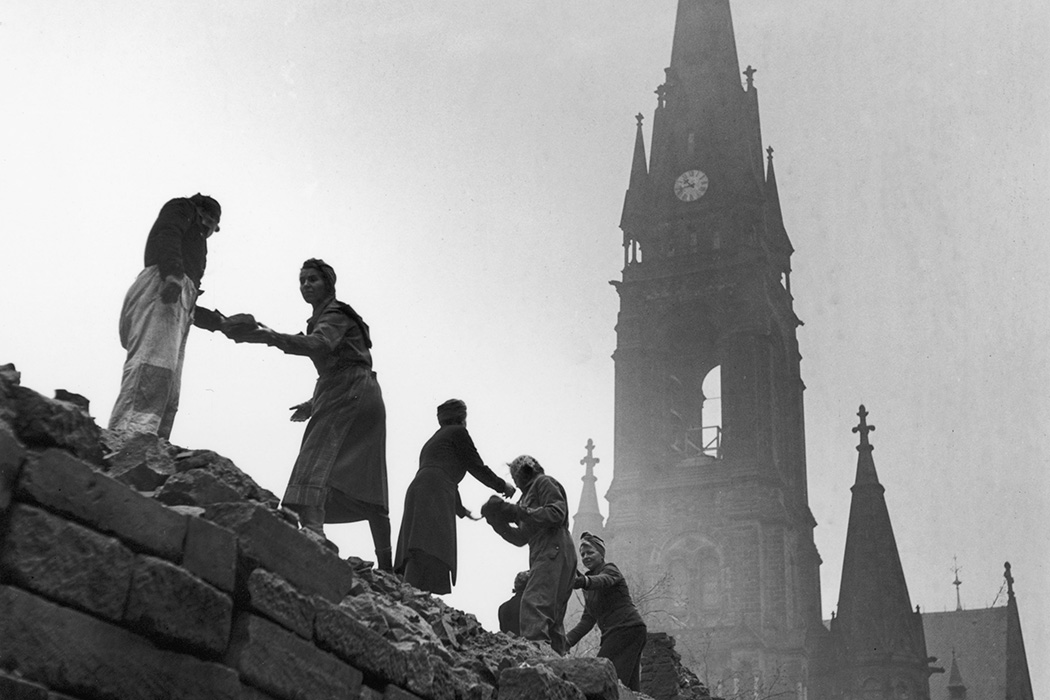 Women form a human chain to carry bricks used in the reconstruction of Dresden, March 1946