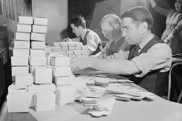 Blind men working on boxes for Elizabeth Arden cosmetics at the Lighthouse, an institution for the blind in New York