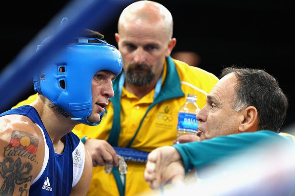 Damien Hooper of Australia listens to advice from his corner during the bout with Juan Carlos Carrillo of Colombia in the Boxing Men's Middle 75kg division on day 11 of the Singapore 2010 Youth Olympics at the International Convention Centre on August 25, 2010 in Singapore