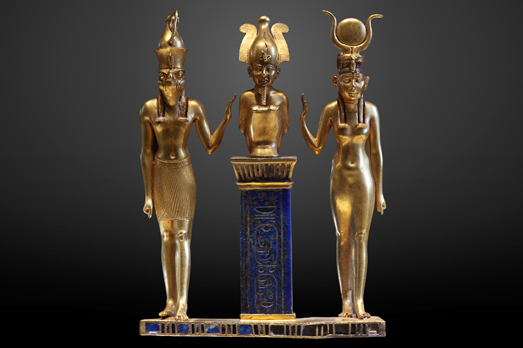 Osiris flanked by Horus on the left and Isis on the right