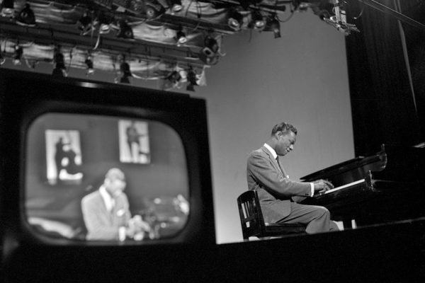 """Nat """"King"""" Cole performs a song on piano on """"The Ed Sullivan Show"""" on April 13, 1958 in New York City"""