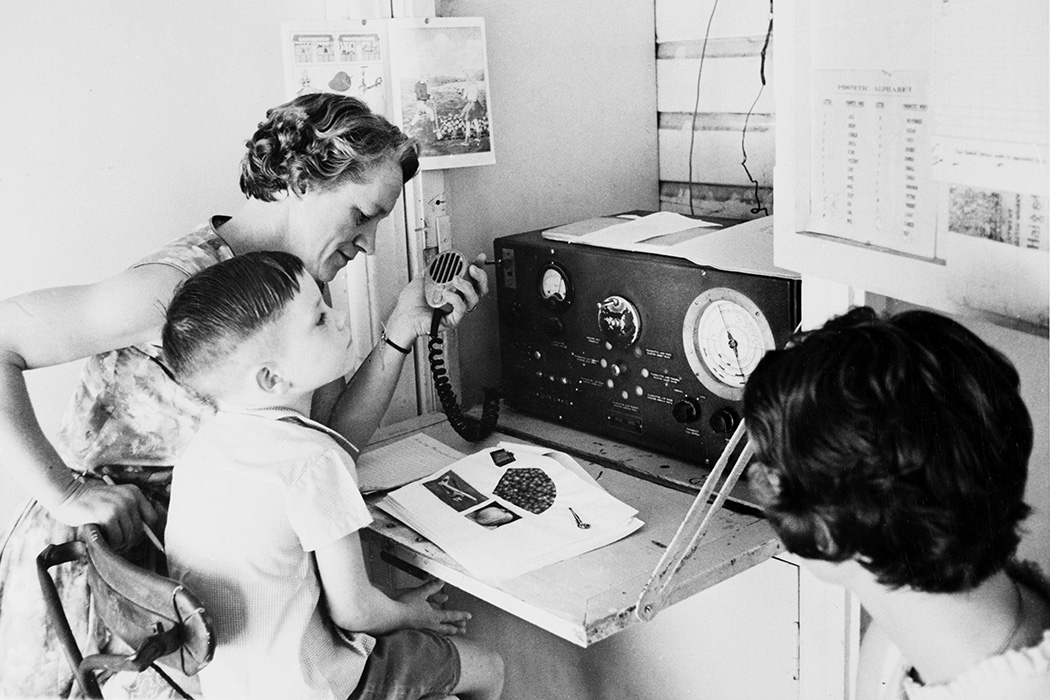 Primary student in regional Queensland takes class via two way radio from Australia's School of the Air, c 1960