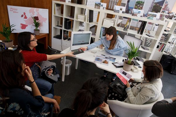A campaigner gives a leaflet to a woman at the Abortion Travel agency store on April 10, 2014 in Madrid, Spain.