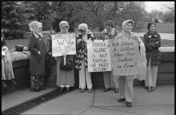 Women from Boston and Charleston, West Virginia, holding signs, demonstrating against textbooks, Washington, D.C., 1975