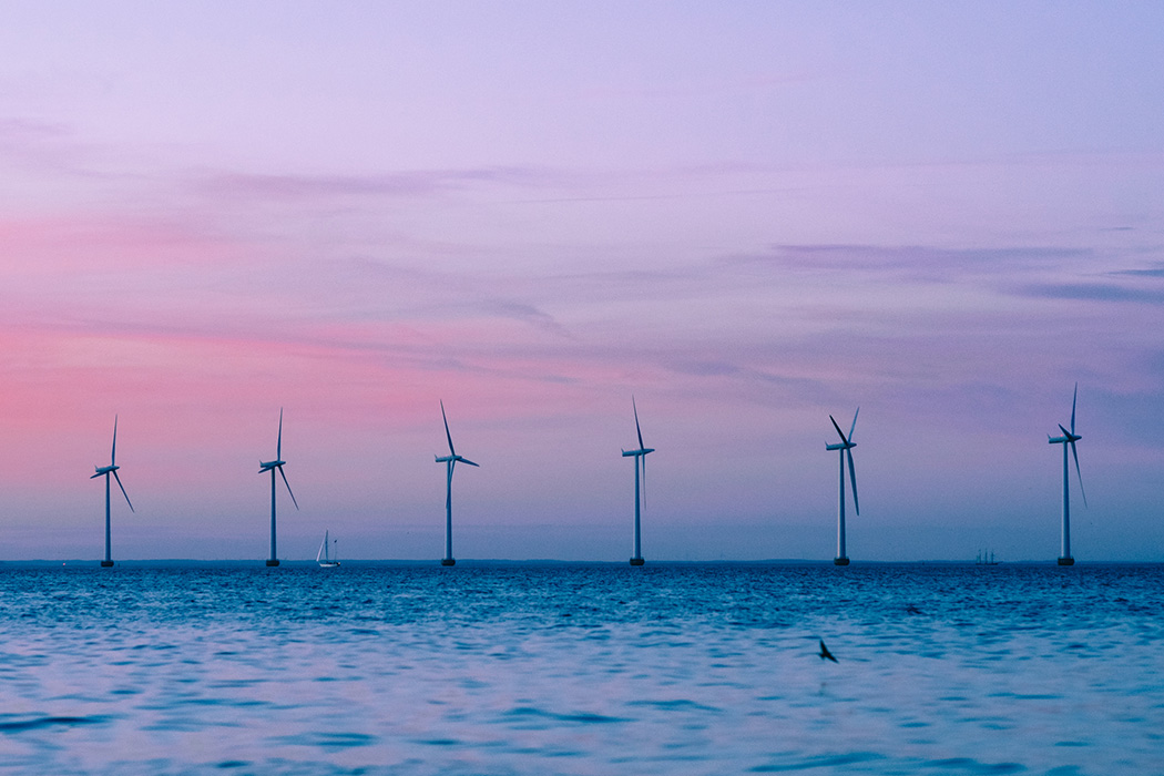 Scenic View Of Wind Turbines Against Sky During Sunset