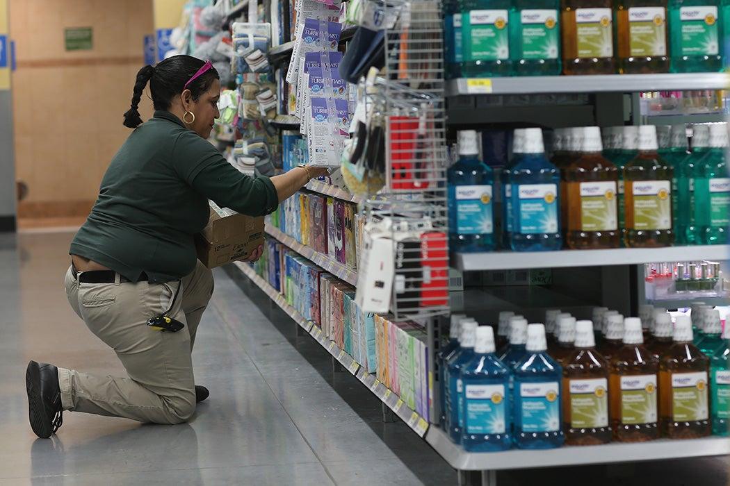 Walmart employee Clara Martinez stocks the shelves at a Walmart store on February 19, 2015 in Miami, Florida.